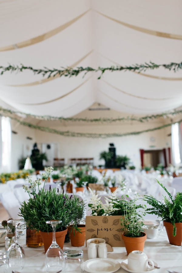 this-portnahaven-hall-wedding-went-totally-natural-by-decorating-with-potted-plants-2-600x900